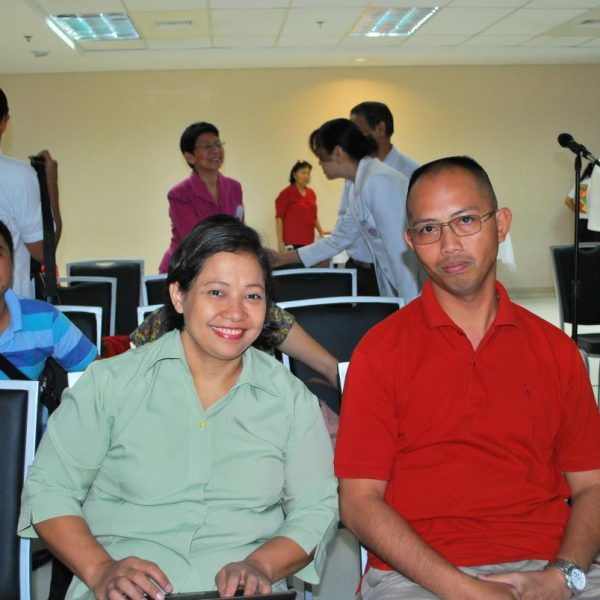 Mr. Rene Macalalad, L (Leukemia Patient) with Ms. Helen Alega, R (Mother of Leukemia Patient Jezreel Alega).  At background are Dr. Demerre and EMC Pastors