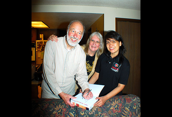 Dr. Erlyn Demerre (right) with Dr. Bob Baugher, Ph.D. and his wife Kris when he donated books to EPCALM in Tacoma, Washington.